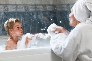 mother-plays-with-child-in-bath
